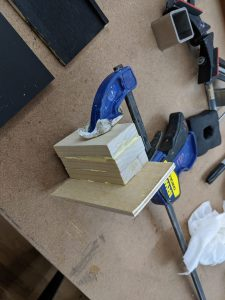 glued wood made stable by the clamps