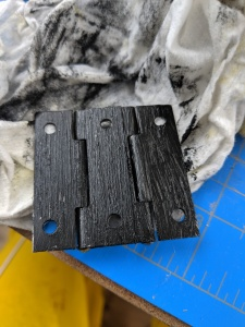 three hinges painted in black