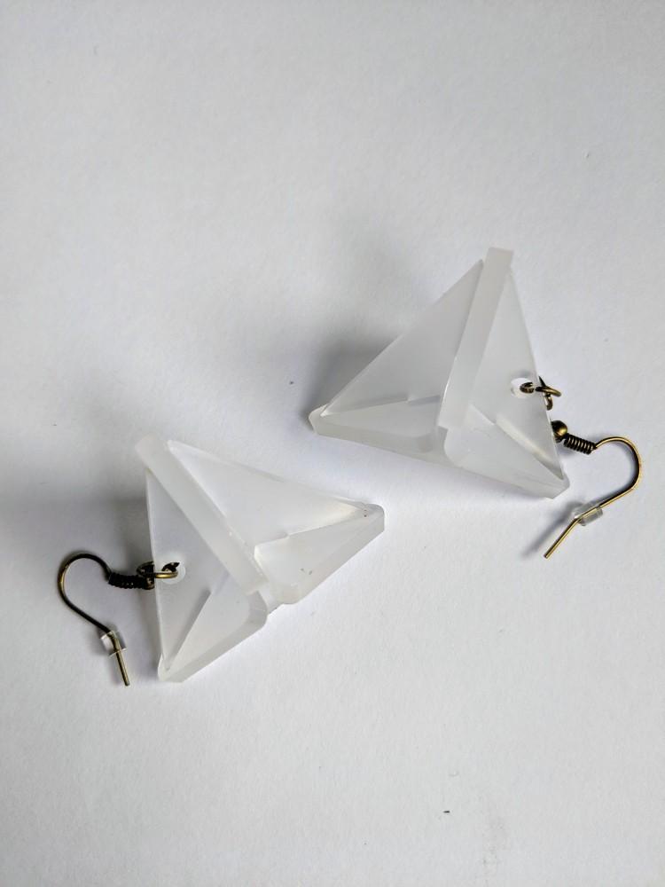 a pair of white triangular earrings
